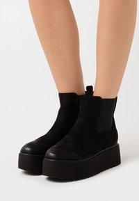 mtng - HIGH SCHOOL - Platform ankle boots - black - 0