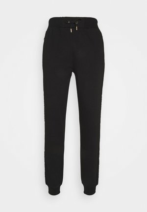 ERSETN  - Tracksuit bottoms - black