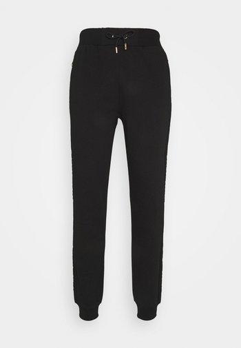 ERSETN  - Pantaloni sportivi - black