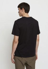 Timberland - WOODWOOD - T-shirt med print - black - 1