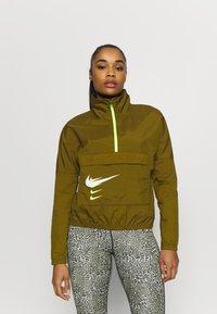 Nike Performance - RUN - Kurtka do biegania - olive flak/volt/white - 0
