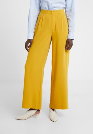 MEGAN - Trousers - misted yellow