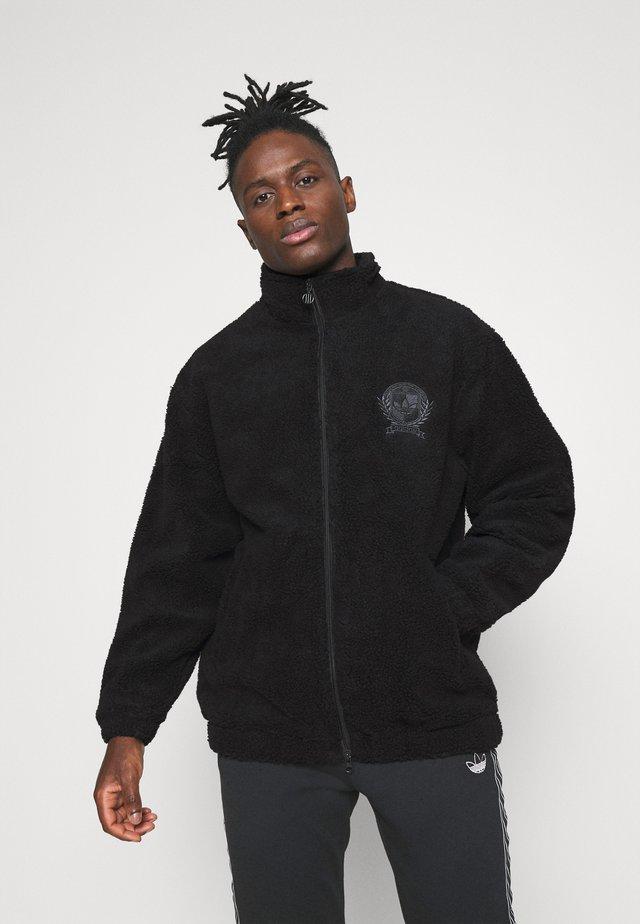 COLLEGIATE CREST TEDDY TRACK JACKET - Light jacket - black