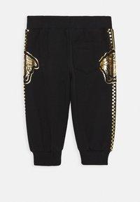 Versace - BOTTOM FELPA UNISEX - Kalhoty - nero - 1