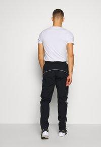 Nike Sportswear - Teplákové kalhoty - black - 2