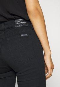 Calvin Klein Jeans - HIGH RISE SKINNY - Jeans Skinny - black denim - 3