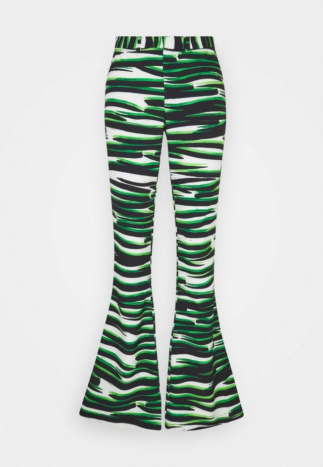 RINA FLARE  - Spodnie materiałowe - white/green