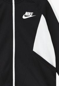 Nike Sportswear - G NSW HERITAGE FZ - Trainingsvest - black/white - 3