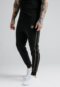 SIKSILK - ASTRO CUFFED TRACK PANTS - Tracksuit bottoms - black/gold - 0