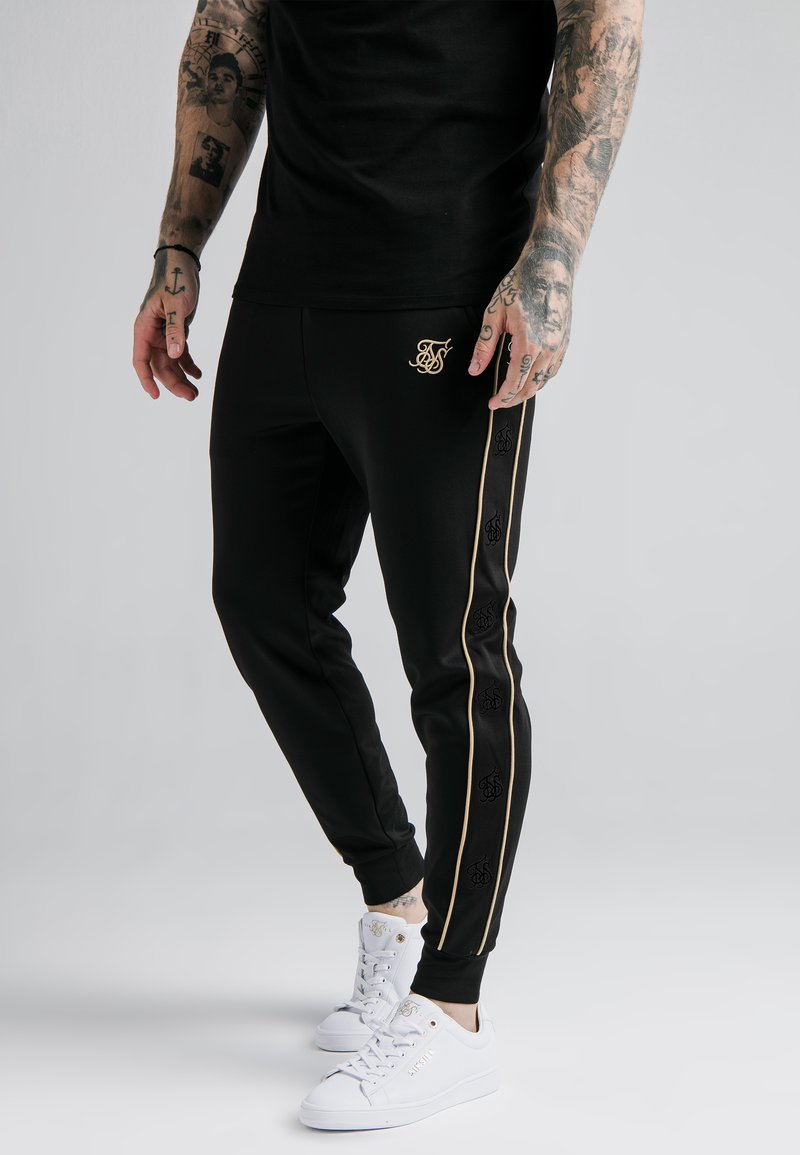 SIKSILK - ASTRO CUFFED TRACK PANTS - Tracksuit bottoms - black/gold