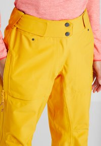 PYUA - RELEASE - Snow pants - pumpkin yellow - 3