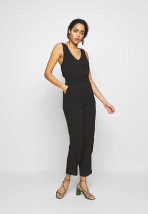 STELLA - Jumpsuit - black