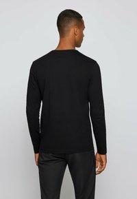 BOSS - Långärmad tröja - black - 2