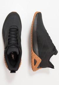 Reebok - TRAIL CRUISER - Trail running shoes - black - 1