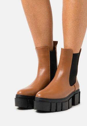 ROXI - Platform ankle boots - tan