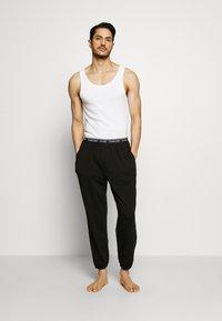 Calvin Klein Underwear - CK ONE JOGGER - Pantaloni del pigiama - black - 1