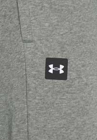 Under Armour - RIVAL - Tracksuit bottoms - pitch gray light heather - 6