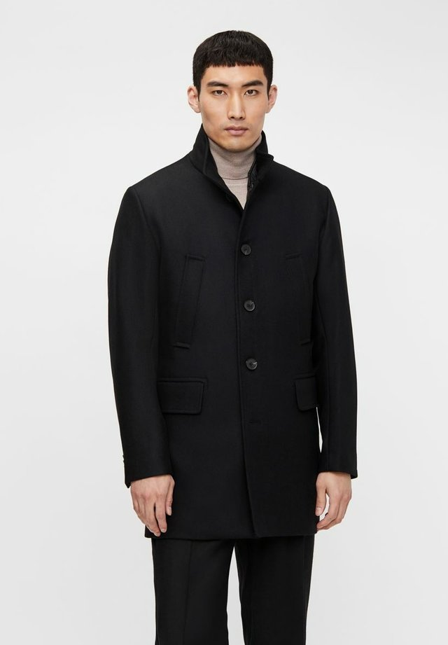 MANTEL KALI - Trenchcoat - black