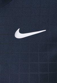 Nike Performance - T-shirt basique - obsidian/white - 2