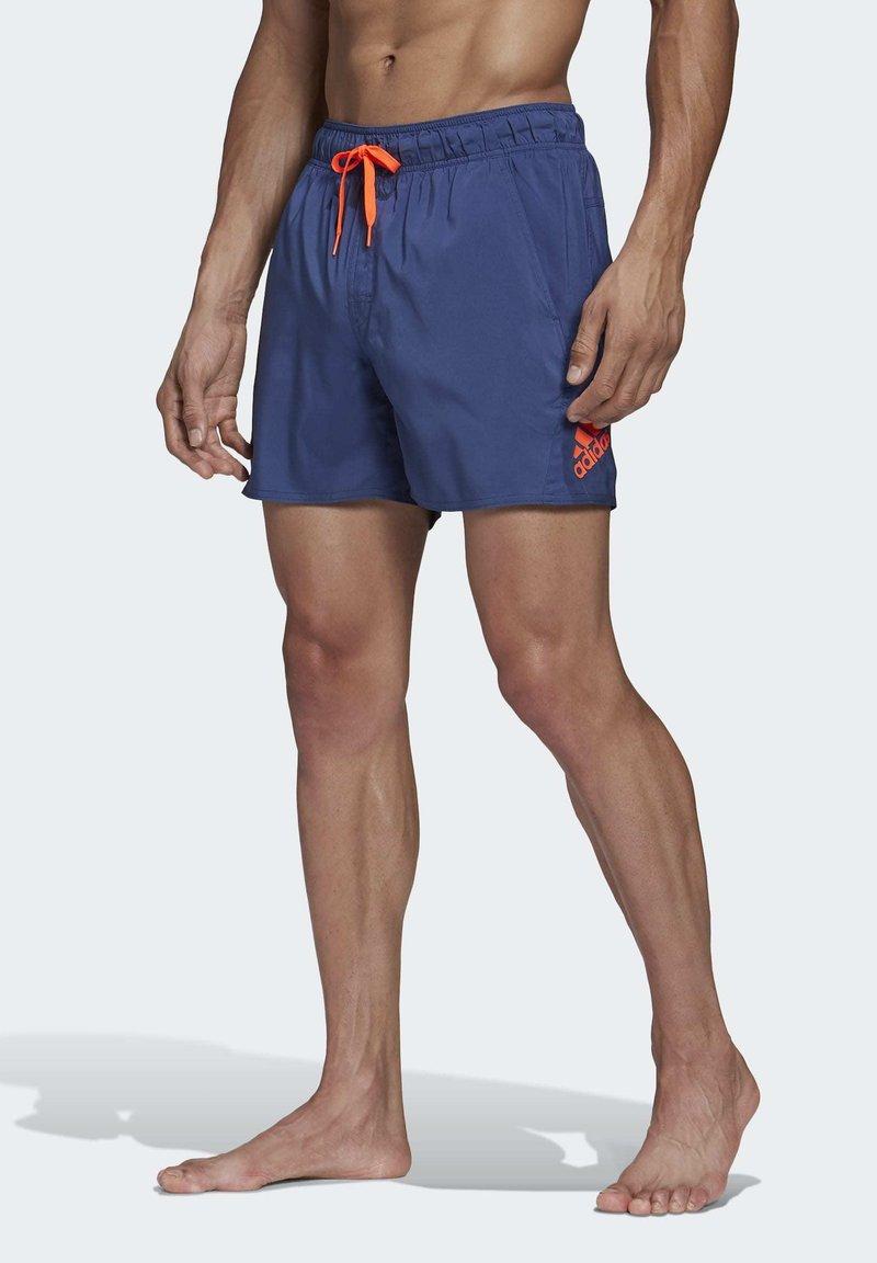 adidas Performance - SOLID TECH SWIM SHORTS - Shorts - blue
