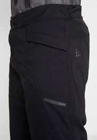 Craft - SUMMIT SHORTS WITH PAD - Krótkie spodenki sportowe - black - 7