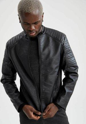 SLIM FIT - Faux leather jacket - black
