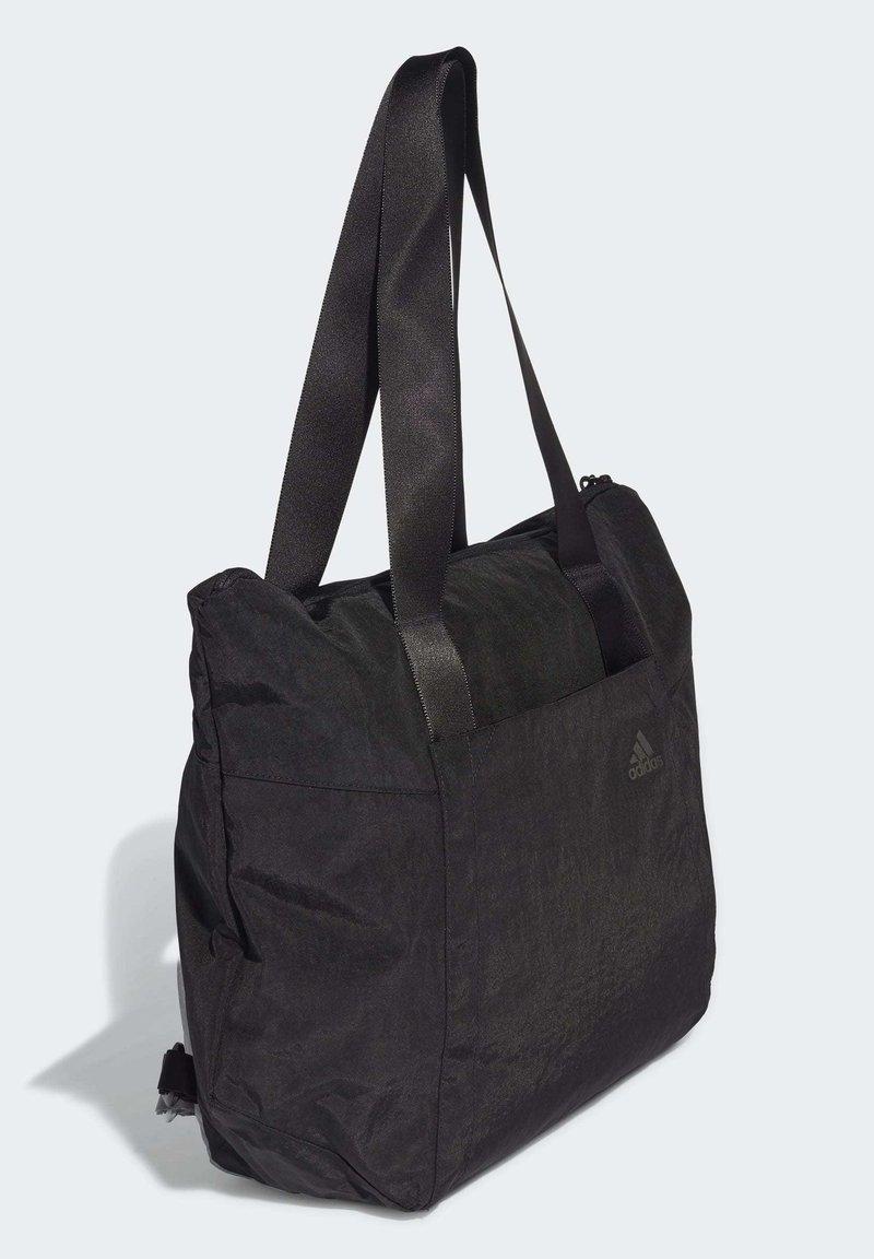Puntuación frecuencia Sabio  adidas Performance TOTE BAG - Across body bag - black - Zalando.de