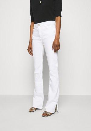 PATCHY - Bootcut jeans - ecru