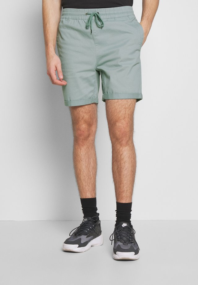 OVER DYED - Shorts - teal