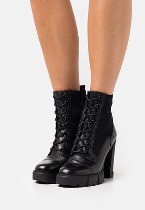 REBEL - Šněrovací kotníkové boty - black