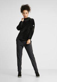 Luhta - ENANNIEMI - Spodnie treningowe - black - 1