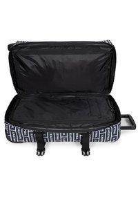 Eastpak - TRANVERZ M - Wheeled suitcase - bold branded - 3