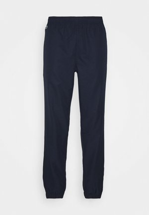 TENNIS PANT - Tracksuit bottoms - navy blue/wasp-white-cosmic