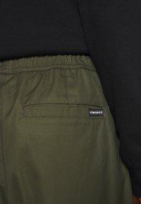 Converse - PANELED JOGGER - Cargo trousers - khaki - 5