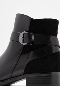 Caprice - Classic ankle boots - black - 2