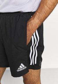 adidas Performance - OWN THE RESPONSE AEROREADY - Korte sportsbukser - black - 4