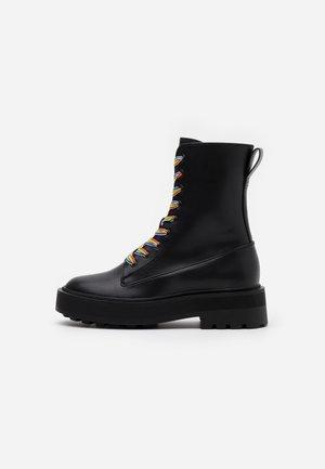 PRIDE - Platform ankle boots - black