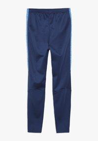 Nike Performance - ACADEMY WINTERIZED - Tracksuit bottoms - coastal blue/photo blue/reflective silver - 1