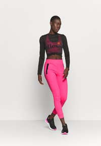 Ellesse - CANA - Tracksuit bottoms - neon pink - 1