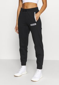 Calvin Klein Performance - PANTS - Tracksuit bottoms - black - 0