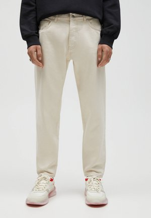 STANDARD  - Straight leg jeans - beige