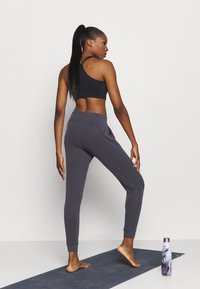 Free People - BACK INTO IT  - Tracksuit bottoms - black - 2