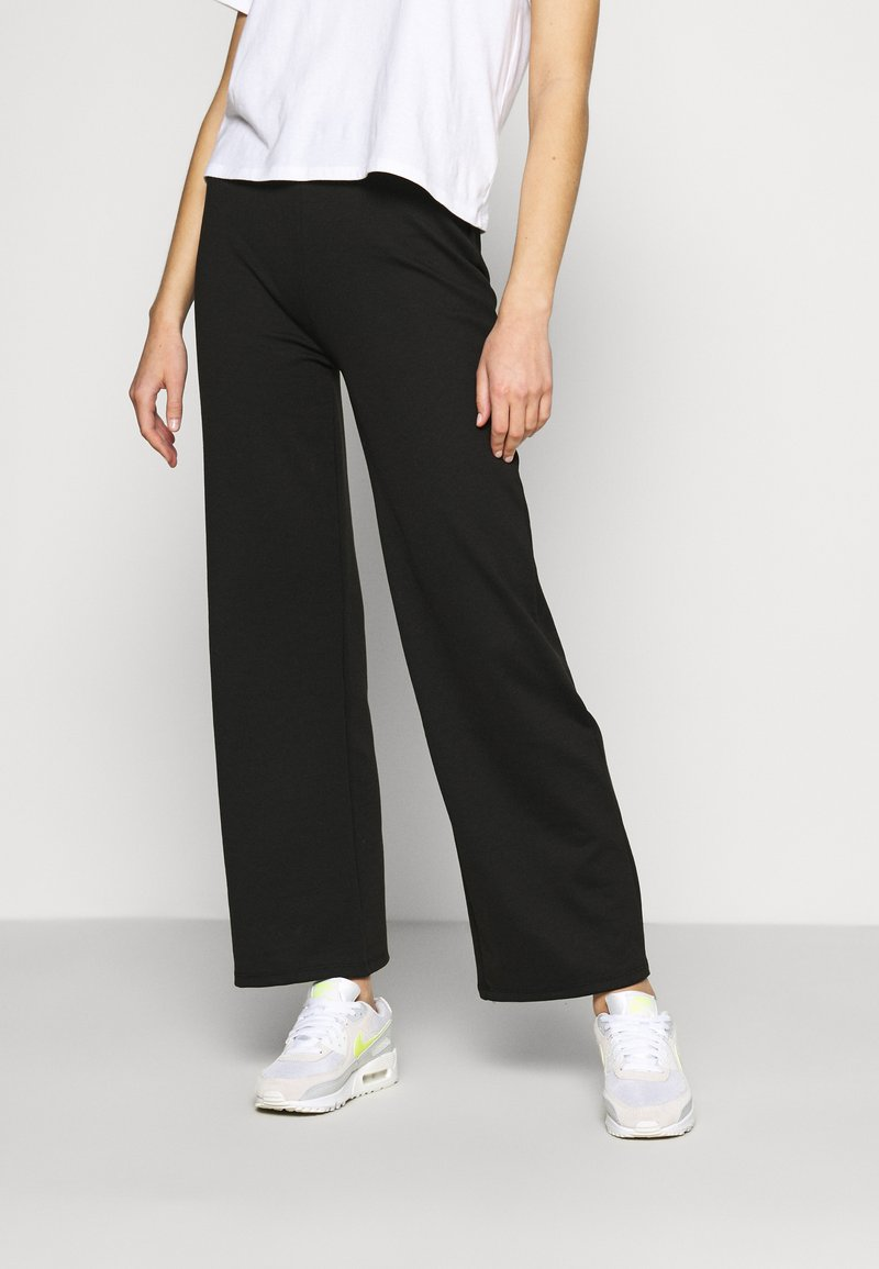 ONLY - ONLFEVER WIDE PANTS - Tracksuit bottoms - black
