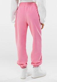Bershka - Tracksuit bottoms - pink - 2