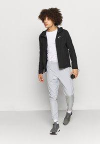 Nike Performance - ESSENTIAL PANT - Tracksuit bottoms - light smoke grey/smoke grey/silver - 1