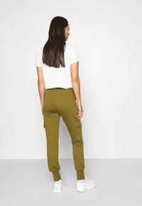 Vero Moda - VMMERCY PANT - Tracksuit bottoms - fir green - 2