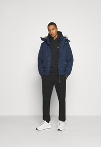 Tommy Jeans - TECH BOMBER UNISEX - Winter jacket - twilight navy - 1