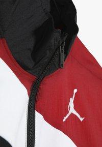 Jordan - WINGS SIDELINE JACKET - Sportovní bunda - gym red - 4