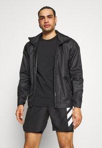 adidas Performance - AGRAVIC SHORT 2-IN-1  - Sports shorts - black/white - 3