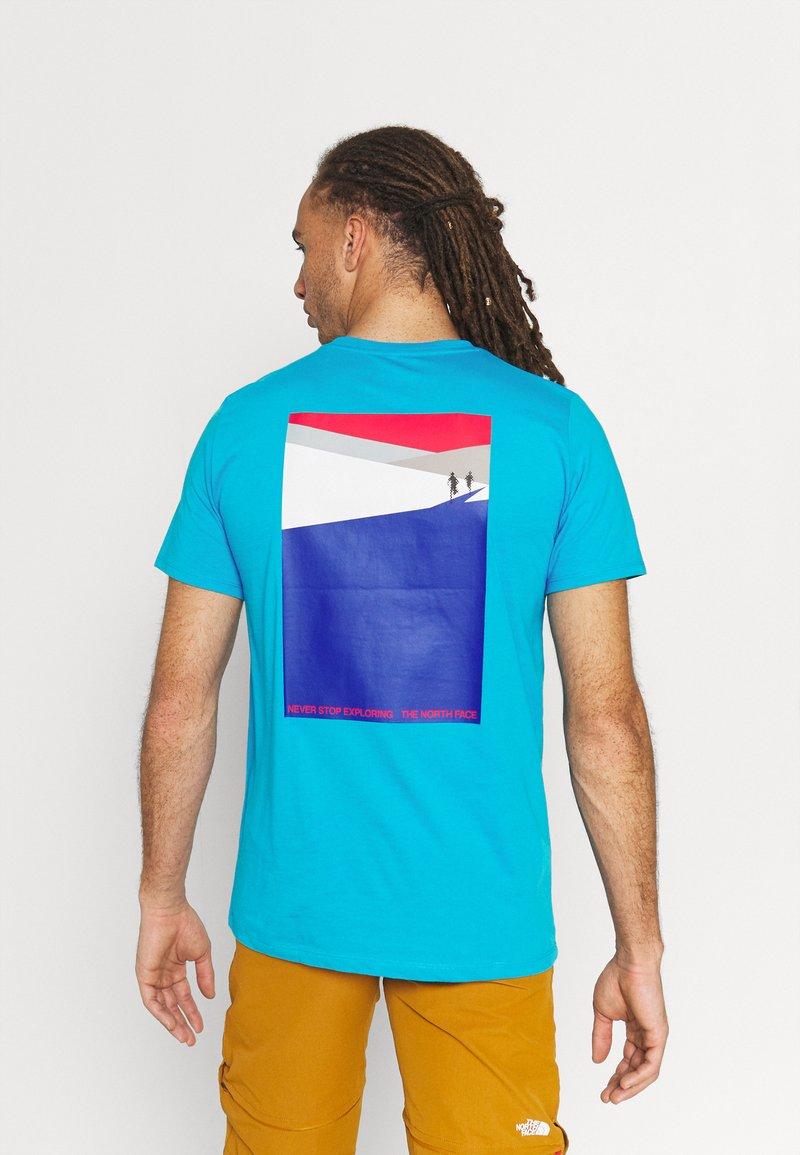 The North Face - FOUNDATION GRAPHIC TEE - Camiseta estampada - meridian blue